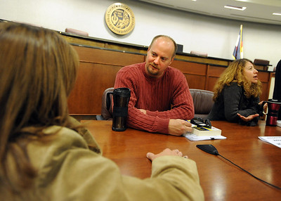 Tim Masters listens to a case from Barbara Hansen, who is involved in a similar case to his. Tim Masters and his post-conviction attorney, Maria Lui, spoke at the University of Colorado Law School on October 13, 2011. The program was sponsored by the Colorado Innocence Project. Masters spent years in prison for a crime he did not commit.  For more photos and a video, go to www.dailycamera.com. Cliff Grassmick / October 13, 2011