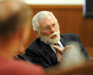 CU law professor, Bill Nagel, answers questions during the panel discussion around the Tim Masters' case. Tim Masters and his post-conviction attorney, Maria Lui, spoke at the University of Colorado Law School on October 13, 2011. The program was sponsored by the Colorado Innocence Project. Masters spent years in prison for a crime he did not commit.  For more photos and a video, go to www.dailycamera.com. Cliff Grassmick / October 13, 2011