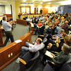 "CU law professor, Pat Furman, left, points out people in the crowd that have questions for the panel.<br /> Tim Masters and his post-conviction attorney, Maria Lui, spoke at the University of Colorado Law School on October 13, 2011. The program was sponsored by the Colorado Innocence Project. Masters spent years in prison for a crime he did not commit.<br />  For more photos and a video, go to  <a href=""http://www.dailycamera.com"">http://www.dailycamera.com</a>.<br /> Cliff Grassmick / October 13, 2011"