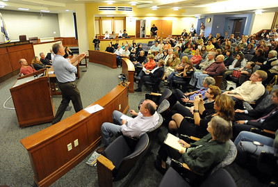 CU law professor, Pat Furman, left, points out people in the crowd that have questions for the panel. Tim Masters and his post-conviction attorney, Maria Lui, spoke at the University of Colorado Law School on October 13, 2011. The program was sponsored by the Colorado Innocence Project. Masters spent years in prison for a crime he did not commit.  For more photos and a video, go to www.dailycamera.com. Cliff Grassmick / October 13, 2011