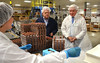 Governor Tom Corbett watches as rasberry truffles are prepared for packaging in a production area during a tour of Asher's Chocolates in Franconia Township.  At center is owner Bob Asher.  Tuesday,  July 8, 2014.  Photo by Geoff Patton