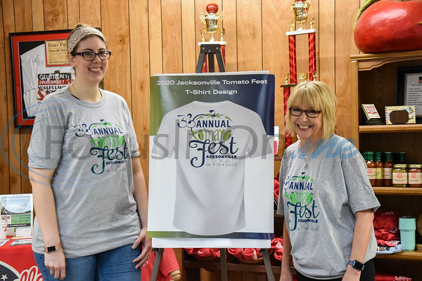 Heather Harris (left), winner of the Jacksonville Chamber Tomato Fest T-Shirt Contest, and Jacksonville Chamber President Peggy Renfro smile for a photo wearing t-shirts with Harris' design. The 36th annual Tomato Fest will be held on Saturday, June 13.