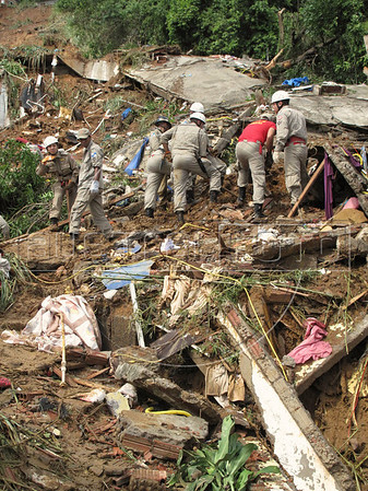 Rescue efforts in Rio de Janeiro, Brazil, in the Prazeres slum, 2 days after torrential rains. At least 107 people were killed in Rio state. (Australfoto/Douglas Engle)