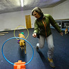KRISTOPHER RADDER — BRATTLEBORO REFORMER<br /> Sara Matters, owner of Training Matters, in Brattleboro, uses treats to train Winnie, a pit/boxer, to go through various hoops on Monday, Jan. 28, 2019.