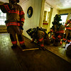 KRISTOPHER RADDER — BRATTLEBORO REFORMER<br /> Members of the Brattleboro Fire Department work on training their new recruit, Nick Bertrand, as they run through rescue drills inside a building on Tuesday, Aug. 20, 2019.