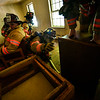 KRISTOPHER RADDER — BRATTLEBORO REFORMER<br /> Nick Bertrand, a new recruit at the Brattleboro Fire Department, tries to leave the room but the entryway is blocked during training on Aug. 20, 2019.