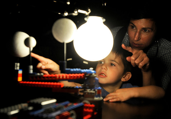 "Javi Slade, 3, and his mother Jenny Slade look at a Lego Orrery to see how planetary motion works while observing the Transit of Venus on Tuesday, June 5, at the Fiske Planetarium and Science Center on the University of Colorado campus in Boulder. For more photos and video of the Transit of Venus go to  <a href=""http://www.dailycamera.com"">http://www.dailycamera.com</a><br /> Jeremy Papasso/ Boulder Daily Camera"