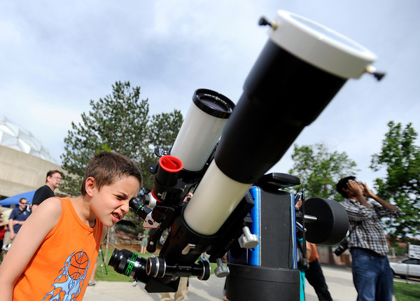 "Leo Diez, 9, of Longmont, looks through a telescope while observing the Transit of Venus on Tuesday, June 5, at the Fiske Planetarium and Science Center on the University of Colorado campus in Boulder. For more photos and video of the Transit of Venus go to  <a href=""http://www.dailycamera.com"">http://www.dailycamera.com</a><br /> Jeremy Papasso/ Boulder Daily Camera"
