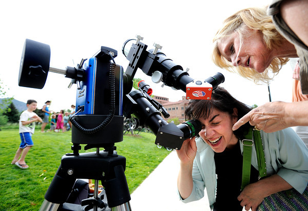 "Astrologers Geri Bellino, of Denver, left, and Sandra-Leigh Serio, of Boulder, look through a telescope while observing the Transit of Venus on Tuesday, June 5, at the Fiske Planetarium and Science Center on the University of Colorado campus in Boulder. For more photos and video of the Transit of Venus go to  <a href=""http://www.dailycamera.com"">http://www.dailycamera.com</a><br /> Jeremy Papasso/ Boulder Daily Camera"