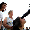 "Teia Lita, 7, looks through a telescope standing in front of her mother Adriana, left, and grandmother Veronica while observing the Transit of Venus on Tuesday, June 5, at the Fiske Planetarium and Science Center on the University of Colorado campus in Boulder. For more photos and video of the Transit of Venus go to  <a href=""http://www.dailycamera.com"">http://www.dailycamera.com</a><br /> Jeremy Papasso/ Boulder Daily Camera"