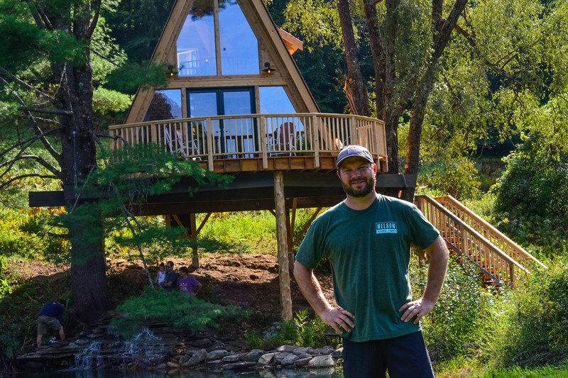 KRISTOPHER RADDER — BRATTLEBORO REFORMER<br /> Steve Bowler, owner of Treehouse Village Inn, in Souther Newfane, Vt., stands proudly next to his new treehouse.