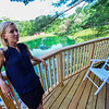 KRISTOPHER RADDER — BRATTLEBORO REFORMER<br /> Christina Salway, the interior designer for Treehouse Masters, stands on the porch while working on the look of a treehouse that they are working on at the Treehouse Village Inn, in South Newfane, Vt., on Monday, Sept. 3, 2018.