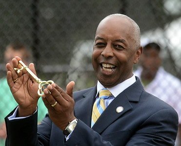 Trenton Mayor Eric Jackson holds the ceremonial key to the tennis pavilion that was presented to him at the dedication. gregg slaboda photo