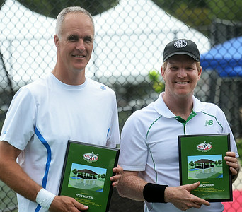 Tennis greats Todd Martin(l)and Jim Courier holds the  plaques they received at the pavilion dedication. gregg slaboda photo