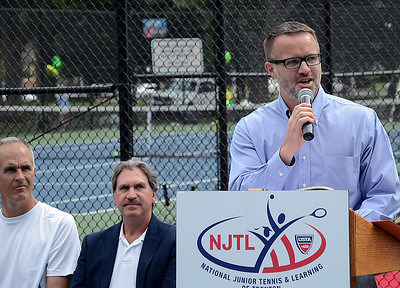 Rob Howland,Executive Director of the NJTL(National Junior Tennis&Learning of Trenton)speaks at the dedication ceremony. gregg slaboda photo