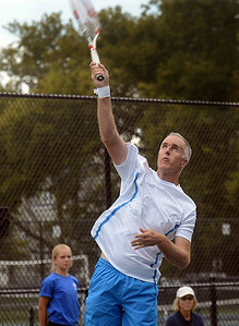 Tennis great Todd Martin serves during a exhibition match against Jim Courier. gregg slaboda photo
