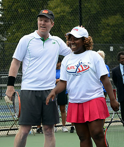 Tennis great Jim Courier(l) and his exhibition match partner Nu-Kermeni Kermah a Trenton High tennis player enjoy a moment at the tennis pavilion dedecation on Friday. gregg slaboda photo