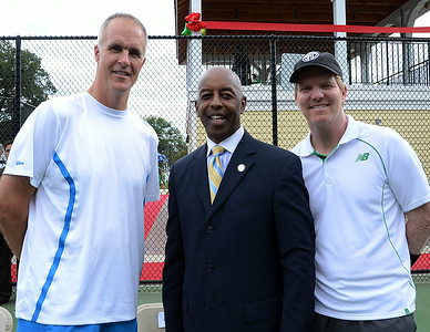 Trenton Mayor Eric Jackson(c)stands with tennis greats Todd Martin(l)and Jim Courier(r)at the dedication of the Daniel L Haggerty Jr. Tennis Pavilion in Cadwalader Park in Trenton on Friday Augeust 16th. gregg slaboda photo