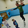 KRISTOPHER RADDER — BRATTLEBORO REFORMER<br /> Troy Wunderle, of Troy Wunderle's Big Top Adventure, dazzles a group of students as he weaves around them on a tall unicycle at Jamaica Village School on Nov. 12, 2019.
