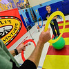 KRISTOPHER RADDER — BRATTLEBORO REFORMER<br /> Kyle Turner tosses rings while balancing on a ball to Troy Wunderle, of Troy Wunderle's Big Top Adventure, as they practice different circus techniques during a weeklong workshop at Jamaica Village School on Nov. 12, 2019.