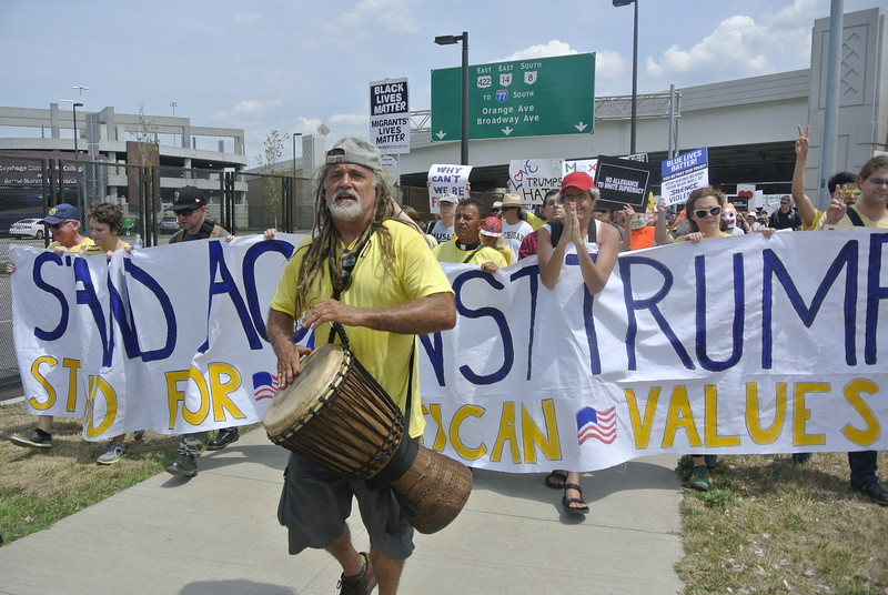 DAVID KNOX / GAZETTE Nearly 300 demonstrators carry banners and signs as they march across Cleveland's historic Lorain-Carnegie Bridge Thursday to protest the Republican Party's nomination of Donald Trump for president.