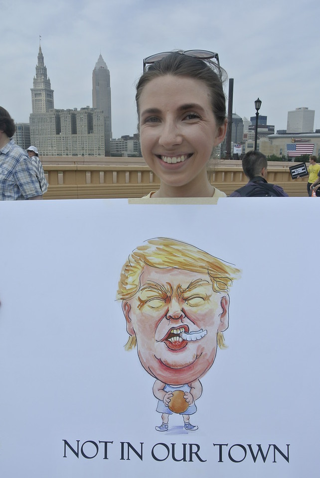 DAVID KNOX/CHRONICLE Oberlin College alumna Faith Robers carries a sign during an anti-Trump rally in downtown Cleveland on Thursday.