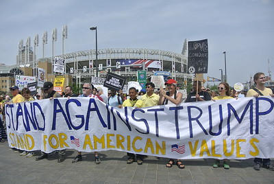 "Anti-Trump protesters celebrate after completing their march along the Republican National Convention's official ""parade route,"" which began at the west end of the nearly mile-long Lorain Carnegie Bridge and continued past Progressive Field."