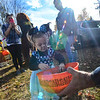 KRISTOPHER RADDER — BRATTLEBORO REFORMER<br /> Mia White, 2, from Chesterfield, N.H., dresses as Minnie Mouse while taking a piece of candy from Chesterfield Police Office John Mousseau during a trunk-or-treat event at the Chesterfield Elementary School, in Chesterfield, N.H., on Saturday, Oct. 26, 2019.