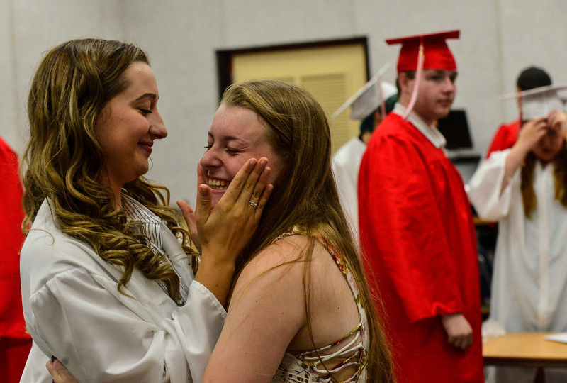 KRISTOPHER RADDER - BRATTLEBORO REFORMER<br /> Graduating senior Jordyn Bolognani hugs freshman Kylie Reed before the start of the Twin Valley Middle High School commencement ceremony on Saturday, June 9, 2018.