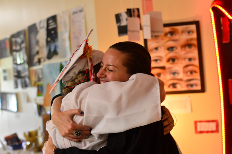 KRISTOPHER RADDER - BRATTLEBORO REFORMER<br /> Graduating senior Izzy Beckwith hugs her art teacher Meghan Rigali  before the start of the Twin Valley Middle High School commencement ceremony on Saturday, June 9, 2018.