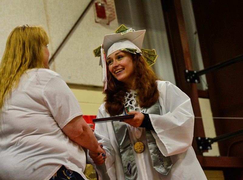 KRISTOPHER RADDER - BRATTLEBORO REFORMER<br /> Taylor Florence, a graduating senior, accepts her diploma during the Twin Valley Middle High School commencement ceremony on Saturday, June 9, 2018.
