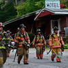 KRISTOPHER RADDER - BRATTLEBORO REFORMER<br /> Firefighters walk back to the command post after the fire was declared under control.