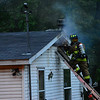 KRISTOPHER RADDER - BRATTLEBORO REFORMER<br /> Sparked fly as firefighter try to vent the attic at a two-alarm fire on Oxbow Road in Hinsdale on Friday, June 16, 2017.