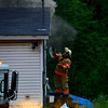 KRISTOPHER RADDER - BRATTLEBORO REFORMER<br /> Firefighters from companies around the tri-state area responded to a two-alarm fire at a home on Oxbow Road in Hinsdale, N.H., on Friday, June 16, 2017.