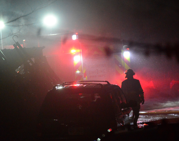 KRISTOPHER RADDER - BRATTLEBORO REFORMER<br /> Crews responded to a two-alarm fire on Elm Street, in Winchester, N.H., on Saturday, Feb. 10, 2018.