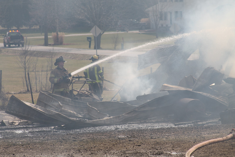 LAWRENCE PANTAGES / GAZETTE Fire fighters from Sharon Township and six other departments offering mutual aid responded to a blaze that demolished a bank barn at 972 Ridgewood Road on Wednesday afternoon.