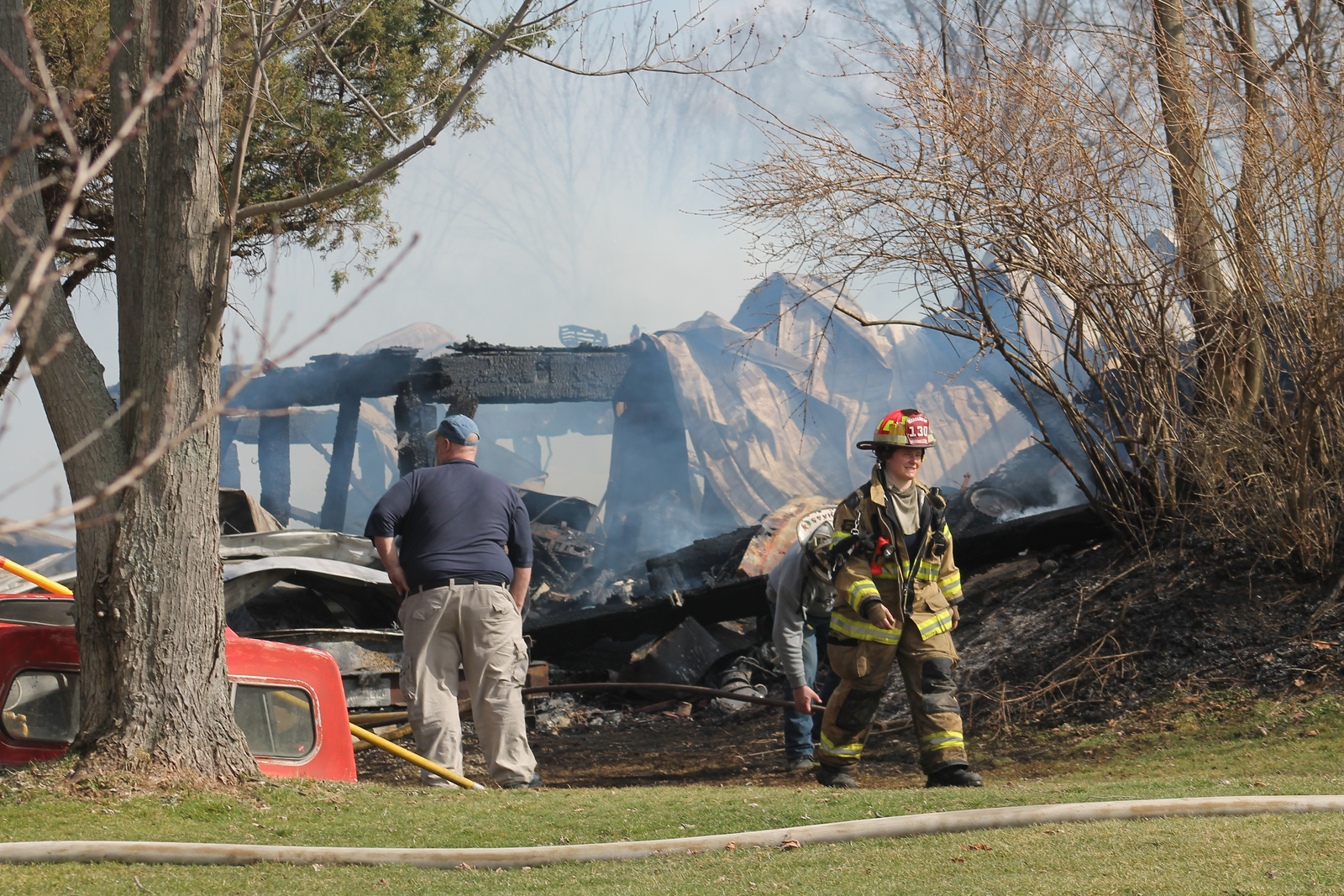 LAWRENCE PANTAGES / GAZETTE A structure called a bank barn was destroyed by fire at 1 p.m. at 792 Ridgewood Road in Sharon Township near the intersection of State Road. Sharon Township Chief Rob Haas estimated the loss at $80,000 to $100,000. He said the 40-by-60 foot barn was used for storage and possibly three vehicles were inside.