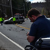 KRISTOPHER RADDER - BRATTLEBORO REFORMER<br /> Derek Morin, of New Hampshire, looks at his cell phone while Vermont State Police investigates the SUV that hit his Jeep on Route 9 on Thursday, April 26, 2018.