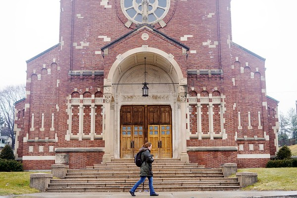 "BEN GARVER — THE BERKSHIRE EAGLE<br /> A woman passes St. Mary Church on Tyler Street in Pittsfield, Friday, December 28, 2018. David Carver is developing the former St. Mary the Morning Star Church on Tyler Street into a 29-unit apartment complex, which city officials have called a ""transformative project"" for the neighborhood."