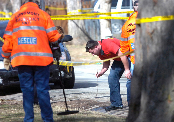 An evidence team checks the area of Pennsylvania Avenue on the Hill at  the scene of an overnight shooting on University Hill on Friday morning.<br /> Photo by Paul Aiken