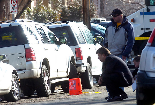 Investigators look over area on Pennsylvania Avenue at  the scene of an overnight shooting on University Hill on Friday morning.<br /> Photo by Paul Aiken