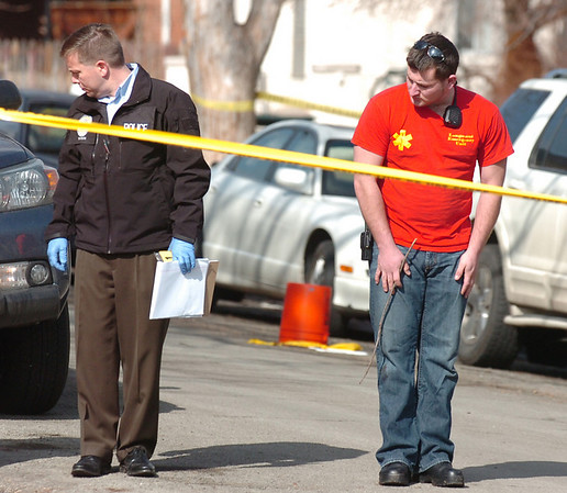 An evidence team member and a member of the Boulder Police check the area of Pennsylvania Avenue on the Hill at  the scene of an overnight shooting on University Hill on Friday morning.<br /> Photo by Paul Aiken