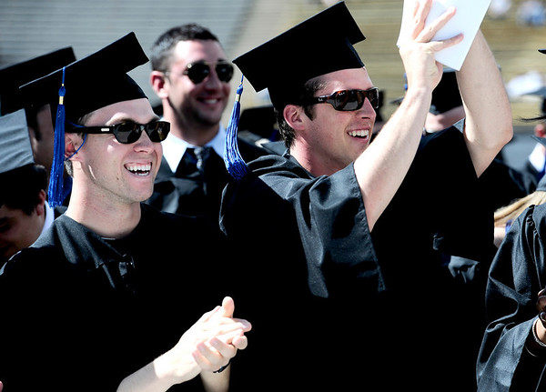 Daniel Cordileone (left) and Ryan Vick (right), both Business Management graduates,  clap during the commencement ceremony held in Folsom Field at the University of Colorado in Boulder, Colorado May 6, 2011.  CAMERA/Mark Leffingwell