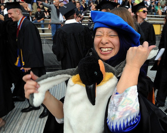 "Sophia B. Lui, celebrates her PhD with her penguin. <br /> A total of 5,897 degrees were conferred during the University of Colorado Spring 2011 Commencement on Friday.<br /> For more photos and a video of graduation, go to  <a href=""http://www.dailycamera.com"">http://www.dailycamera.com</a>.<br /> Cliff Grassmick/ May 6, 2011"