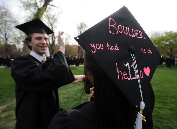 """Lisa Cahill, right, has a message on her cap for graduation.<br /> A total of 5,897 degrees were conferred during the University of Colorado Spring 2011 Commencement on Friday.<br /> For more photos and a video of graduation, go to  <a href=""""http://www.dailycamera.com"""">http://www.dailycamera.com</a>.<br /> Cliff Grassmick/ May 6, 2011"""