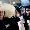 Dani Vhnavy, graduate in Marketing, sit comfortably in the hot sun protected by her large sombrero during the commencement ceremony held in Folsom Field at the University of Colorado in Boulder, Colorado May 6, 2011.  CAMERA/Mark Leffingwell