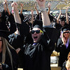 "Matthew Wessler, from the College of Architecture & Planning raises his hands in a cheer as 5,897 degrees were conferred during the University of Colorado Spring 2011 Commencement on Friday.<br /> For more photos and a video of graduation, go to  <a href=""http://www.dailycamera.com"">http://www.dailycamera.com</a>.<br /> Cliff Grassmick/ May 6, 2011"