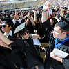 "Journalism grads, Michelle Davenport, left, and Alex Schultz, celebrate their graduation near the end of the ceremony.<br /> A total of 5,897 degrees were conferred during the University of Colorado Spring 2011 Commencement on Friday.<br /> For more photos and a video of graduation, go to  <a href=""http://www.dailycamera.com"">http://www.dailycamera.com</a>.<br /> Cliff Grassmick/ May 6, 2011"
