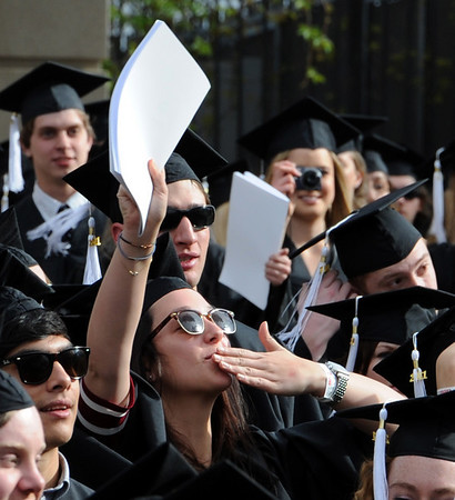 "Madeline Hennessy blows a kiss to her family as she enters Folsom Field.<br /> A total of 5,897 degrees were conferred during the University of Colorado Spring 2011 Commencement on Friday.<br /> For more photos and a video of graduation, go to  <a href=""http://www.dailycamera.com"">http://www.dailycamera.com</a>.<br /> Cliff Grassmick/ May 6, 2011"