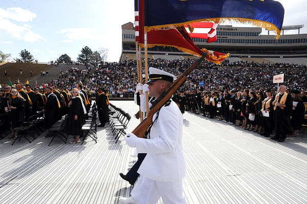 """The color guard marchs in to start the ceremony.<br /> A total of 5,897 degrees were conferred during the University of Colorado Spring 2011 Commencement on Friday.<br /> For more photos and a video of graduation, go to  <a href=""""http://www.dailycamera.com"""">http://www.dailycamera.com</a>.<br /> Cliff Grassmick/ May 6, 2011"""